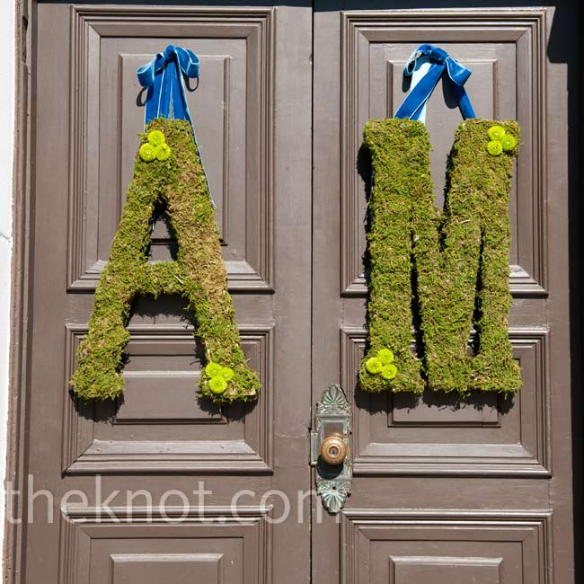 The moss-covered initials of the couple were hung on the front door of Crane Cottage.