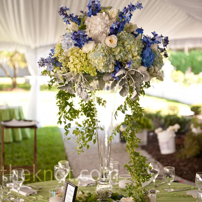 Tall fluted vases filled with lush blooms graced some of the tables. The bases were surrounded with moss and vines for an organic, garden feel.