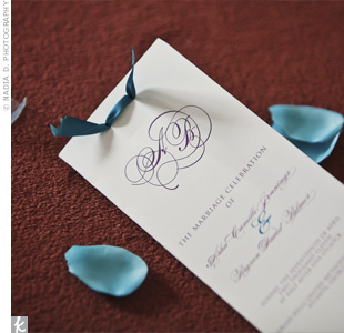 An elegant eggplant script and a teal satin ribbon added color to the white cotton paper used for the programs.