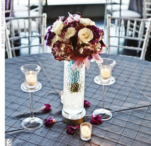 The bridesmaid bouquets were repurposed as centerpieces and placed in vases filled with water beads surrounded by petals and votive candles.