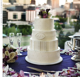 The cake was decorated with a different white-on-white pattern on each of the four tiers and topped with a nosegay of fresh flowers.