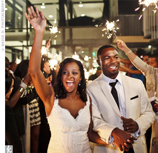 Friends and family waved sparklers as Asha and Bryson made their exit from the reception.