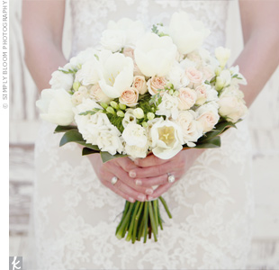 Ashley carried a bouquet of peonies, roses and lisianthus in soft shades of cream and peach, framed with a collar of green leaves.