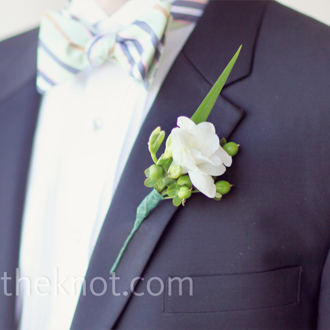 A white flower accented with a spike of grass and hypericum berries made up Kemble's masculine boutonniere.