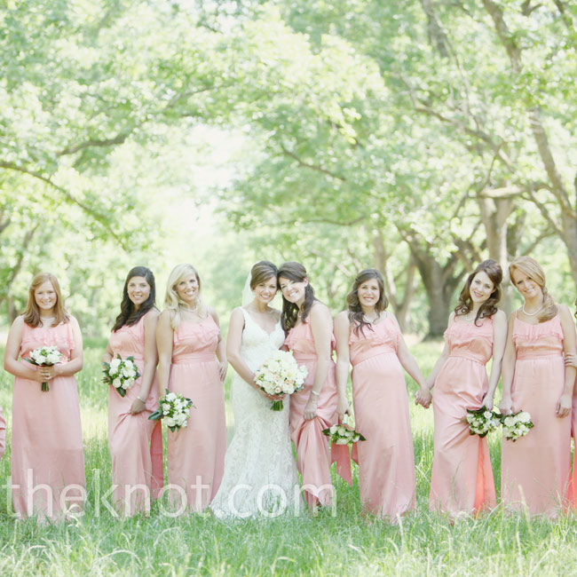 Long, peach dresses with ruffled necklines were a flattering choice for the 10 bridesmaids.