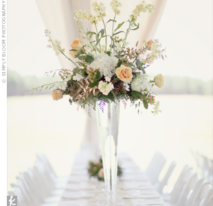 Tall glass vases filled with peach and cream blooms were placed on graphic table runners.