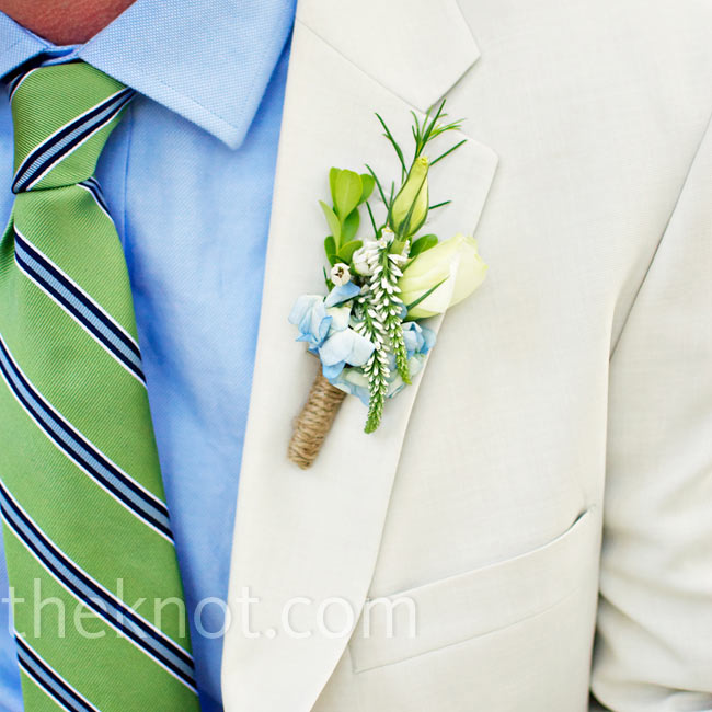Joseph's boutonniere mimicked the flowers from Jessica's bouquet and was wrapped in jute for a natural look.