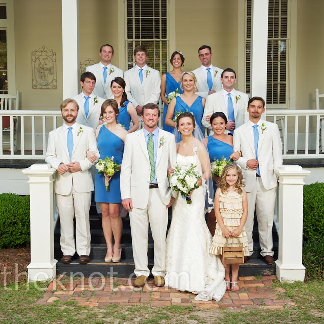 The guys wore tan linen suits with blue ties to coordinate with the bridesmaids' crisp blue dresses.
