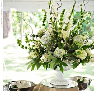 Hydrangeas, bells of Ireland, curly willow and oak leaves were placed in a ceramic vase, creating a dramatic yet earthy arrangement.