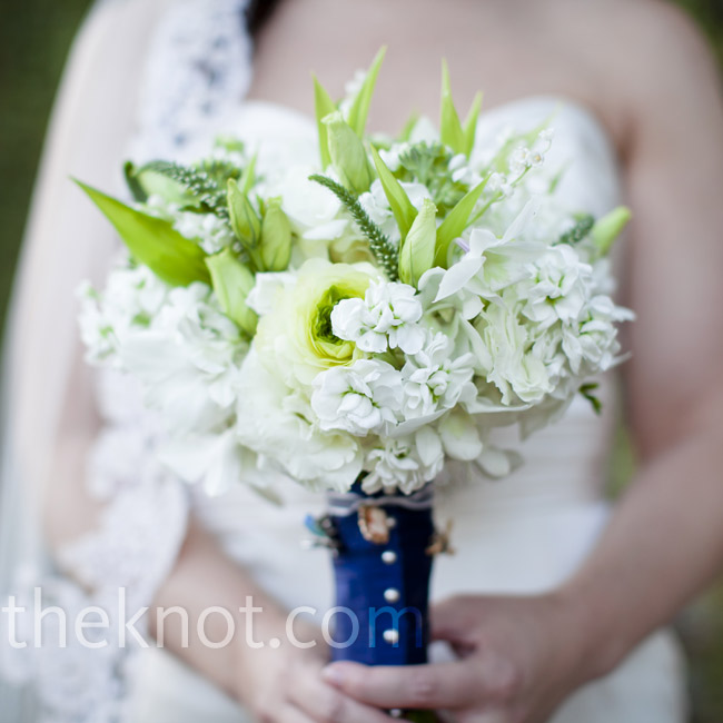 Subtle touches of green enhanced Margi's white bouquet of dahlias, ranunculus, sweet peas, roses and orchids.