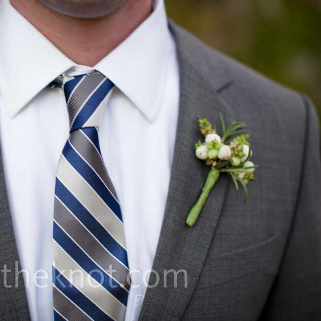 Green and white berries wrapped in ribbon added a spot of color to Wes's gray suit and striped tie.