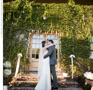 Margi and Wes held their ceremony on the courtyard steps against a backdrop of climbing ivy.