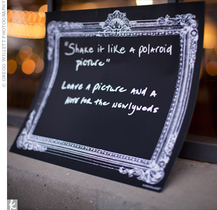 A white-on-black image of an ornate frame encouraged guests to take a picture for the guest book.