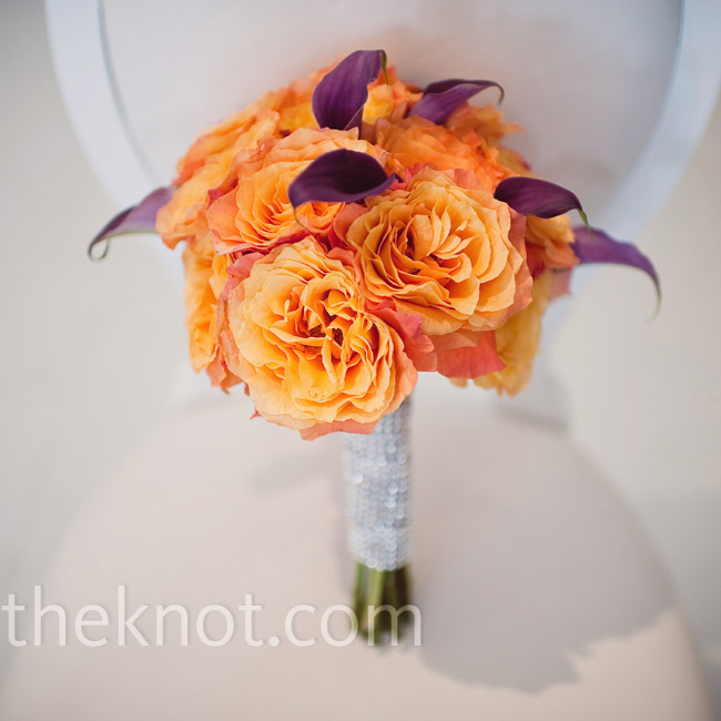 Purple mini calla lilies studded Melissa's vibrant bouquet of orange circus roses while a blinged-out bouquet wrap brought in some additional glamour.