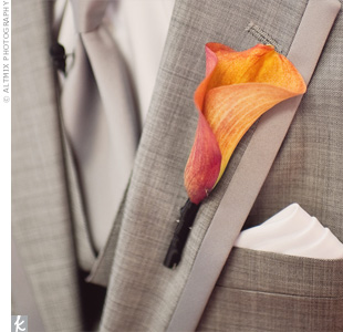 A simple orange calla lily boutonniere was the perfect complement to Thea's crisp gray suit.