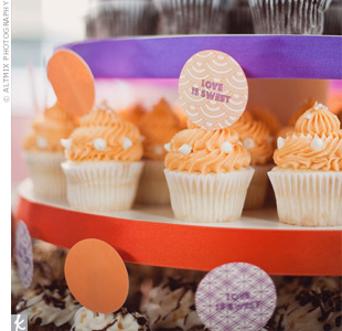 Festive ribbons and cardstock dots brought vivid color to the tower that served up cupcakes in four decadent flavors.