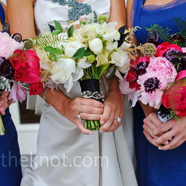 Katie carried a textured bunch of white peonies and ranunculus, while her maids of honor held bright and pale pink peonies mixed with fiddlehead ferns.