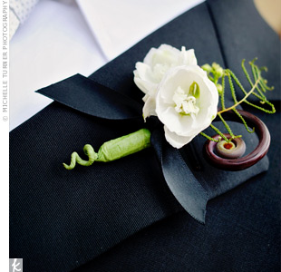 A fiddlehead fern added a whimsical touch to Mike's classic white scabiosa boutonniere.