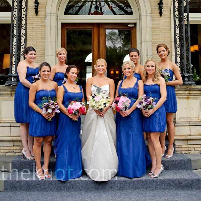 The bridesmaids were dressed in short, strapless blue dresses, while the maids of honor wore the same color in a more formal floor-length style.