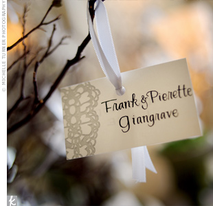 To bring the garden vibe into the dining room, the escort cards hung from tree branches.