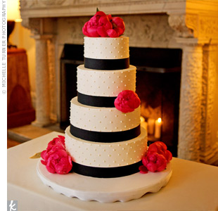 Swiss dots and black-grosgrain ribbon decorated the round cake for a clean, modern look, while hot pink peonies added some color.