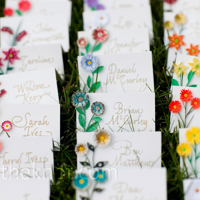 Jenn's mom (a craft paper-quiller) hand-quilled tiny flowers and attached them to each escort card.