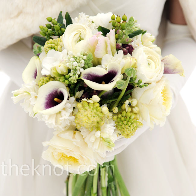 Anne carried purple-centered white calla lilies, ranunculus and peonies, with green accents of coffee berries and ferns.
