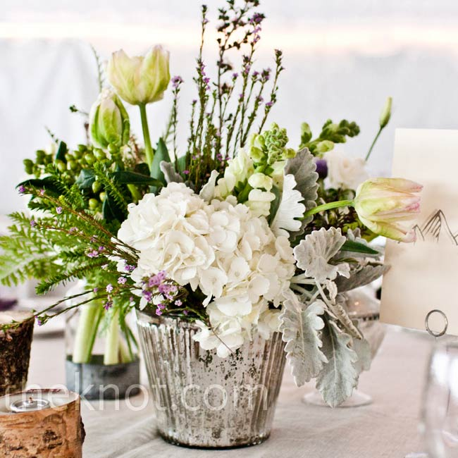 Hydrangeas, freesias, artemisia and tulips topped the tables. A mix of mercury glasses, birch vases and votives dressed up the rustic look.