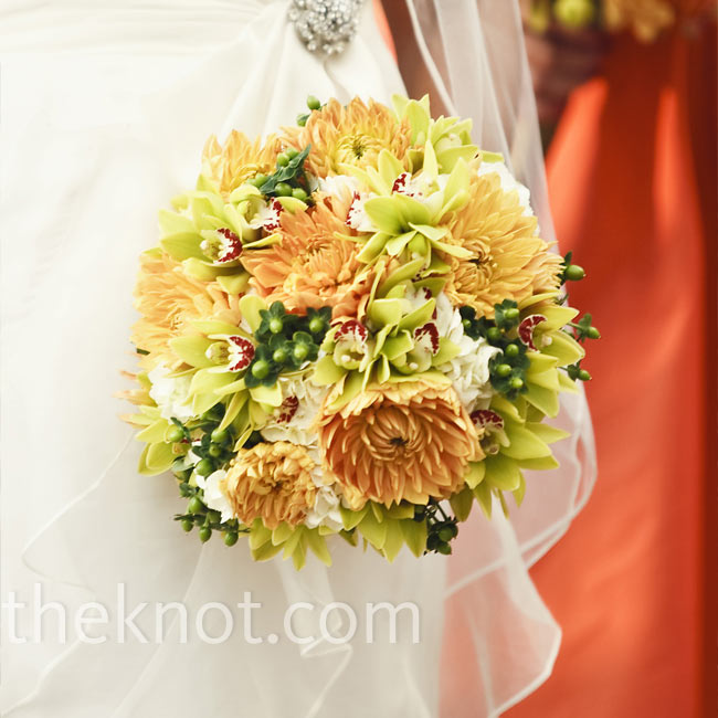Anelena carried off-white hydrangeas, green mini orchids and orange dahlias.