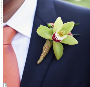 The groom wore a green mini cymbidium orchid and an orange Mokara orchid.
