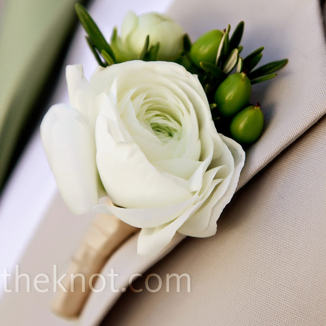 Rosemary, green berries and white ranunculus made up the groom and groomsmen's boutonnieres.