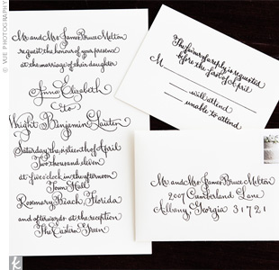The custom invitations consisted of script calligraphy engraved on cotton paper.