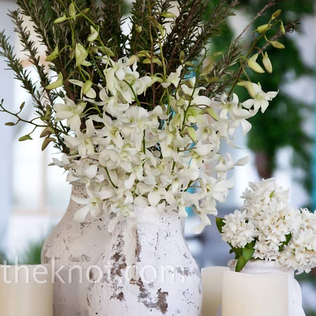 French pottery vessels filled with magnolia leaves and white cherry blossoms flanked the ceremony altar.