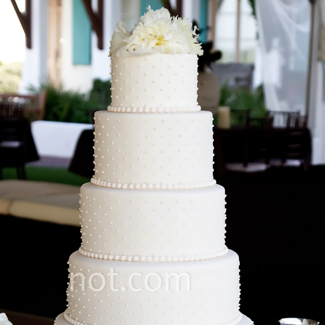The five-tiered cake was studded with pearls and topped with peonies.