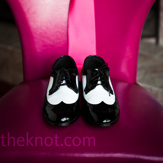 The groom, along with his groomsmen, wore black-and-white lace-up shoes.
