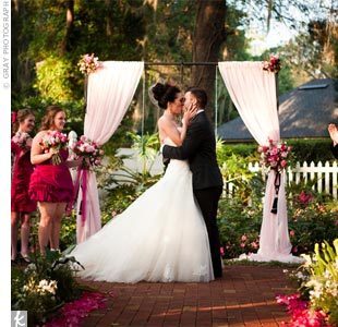 Despite a forecast for rain, the couple got lucky with a beautiful sunset ceremony.