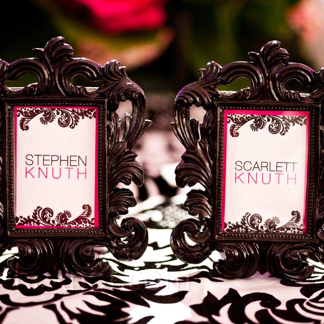 Black vintage-style frames were used as place cards for the couple's reception seats.