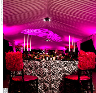 Pink uplighting created a reception that was instantly vibrant and feminine.