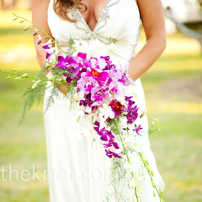 April carried a tropically bright bouquet of cascading purple and white orchids.