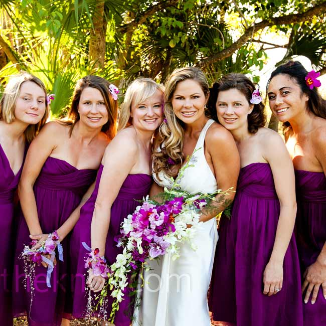 Each of the bridesmaids wore a strapless dress in soft crinkle chiffon in the color of spiced wine, to match the jewel tones of the day.