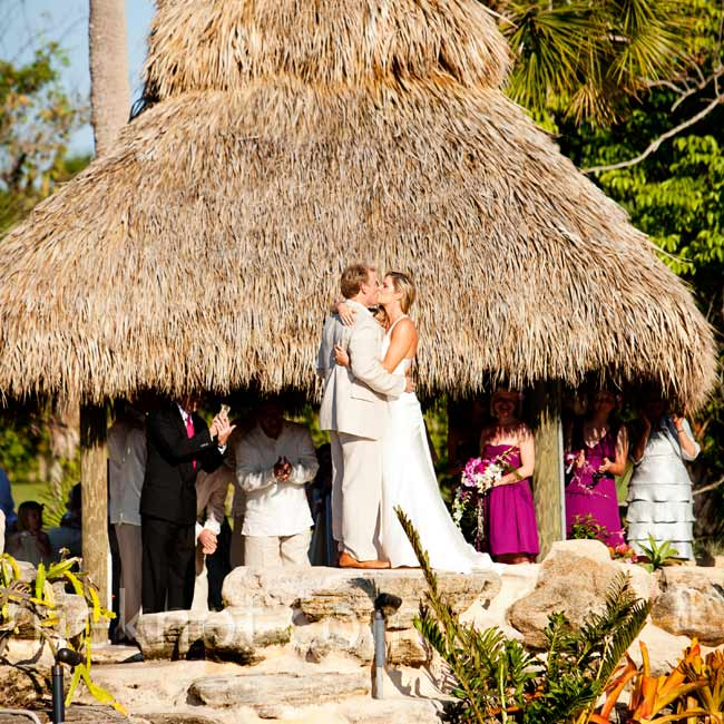 "The couple said ""I do"" in a tiki hut built just for the ceremony in their backyard."
