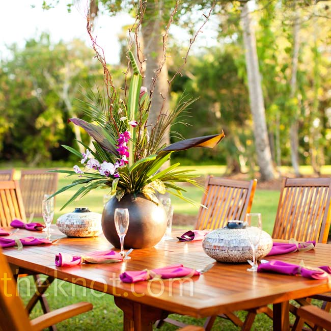 April chose teak tables with stone vases to hold grasses, orchids and heliconia.