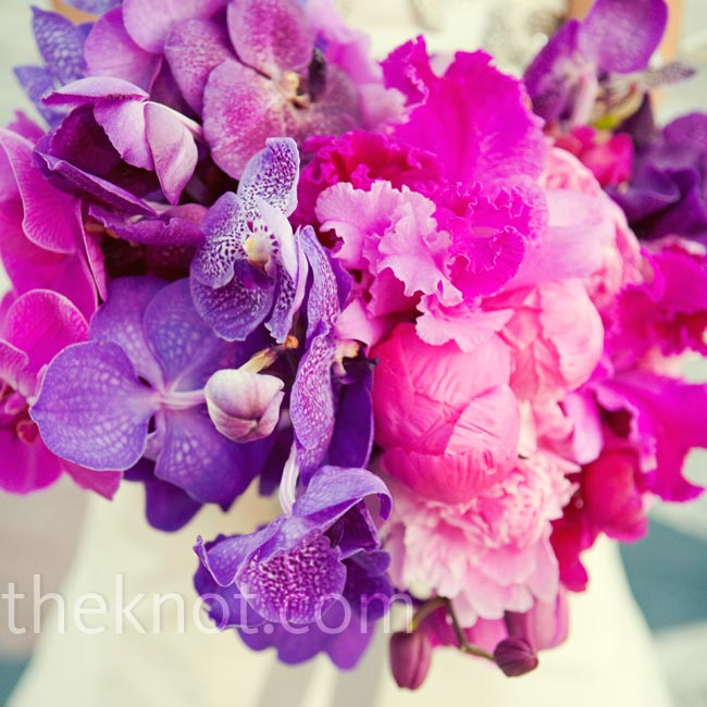 Vanda orchids, peonies, phalaenopsis orchids and cattelya orchids made up Adina's loose bouquet.