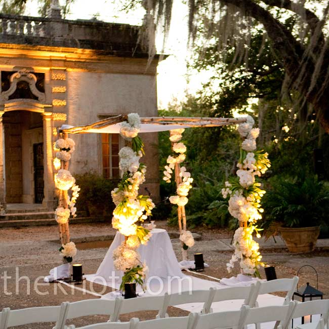 White hydranges, tulips and orchids decorated the couple's natural-looking wooden huppah.