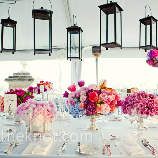 The ceremony décor was all white, but Adina and Dan chose pink and cornflower blue flowers to top the tables. Lanterns hanging from above had a cool look.
