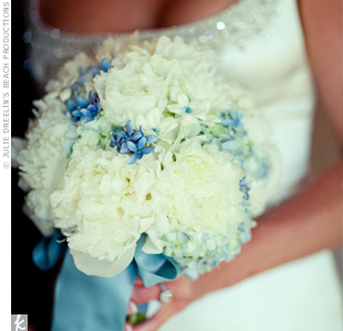 White peonies, stephanotis and blue hydrangea were accented with tiny crystals and wrapped in a blue silk ribbon to coordinate with the groom's tie.