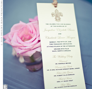 A champagne-hued ribbon dressed up the ecru programs, which were personalized with the fleur de lis motif.