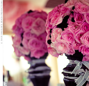 The bar area was brightened up with black vases filled with hot pink roses and wrapped in striped grosgrain ribbon.