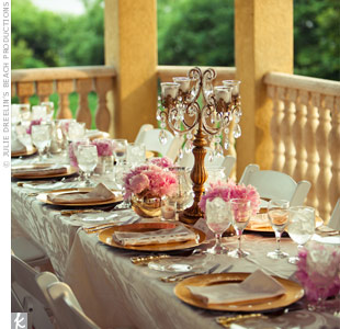 Dramatic gold and crystal candelabras were surrounded by pink peonies in gold and silver mercury glass.