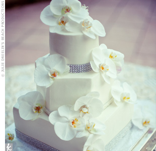 The three-tiered cake was decorated with cascading orchids and jeweled bands that mimicked Jacqueline's dress.